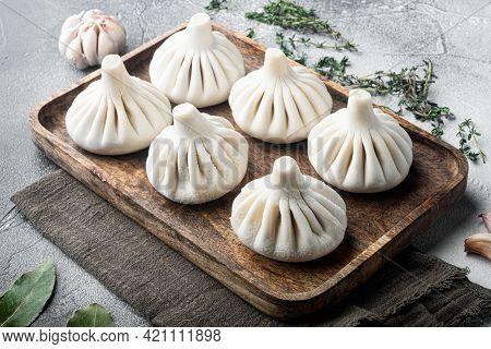 Uzbek Manti. Manti Or Manty Dumplings, Popular Uzbek-asian Dish Set, On Gray Stone Background
