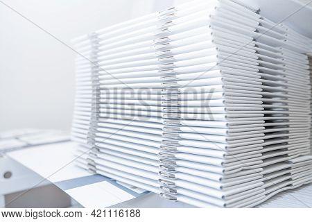 Large Number Of Folded Cardboard Boxes .cardboard Boxes Stored. Pile Of Collapsed Cardboard Boxes.