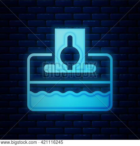 Glowing Neon Donate Or Pay Your Zakat As Muslim Obligatory Icon Isolated On Brick Wall Background. M