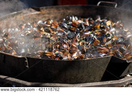 Delicious Mussels Boiling In Big Bowl, Cooking Seafood At Open Air Kitchen. Preparing Yummy Mussels
