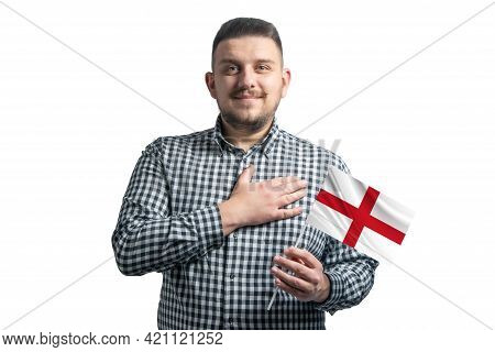 White Guy Holding A Flag Of England And Holds His Hand On His Heart Isolated On A White Background W