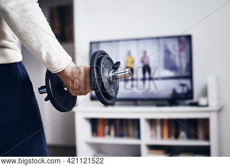 Man working out at home lifestyle. Home workout in living room lifestyle. Man exercising at home. Lifestyle. Home workout lifestyle. Workout lifestyle. Man adult workout at home with weights. Weights workout,