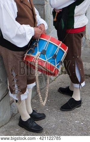 Two Men Dressed With Traditional Asturian Costumes With A Drum. Celebration In Asturias, Spain
