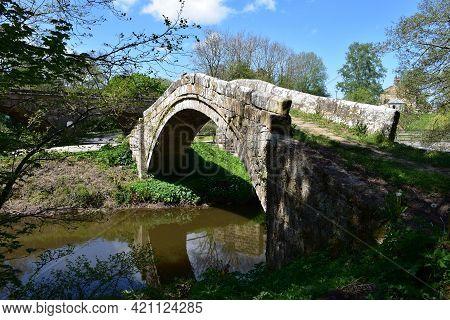 Historic Look At Beggar's Bridge Over The River Esk.