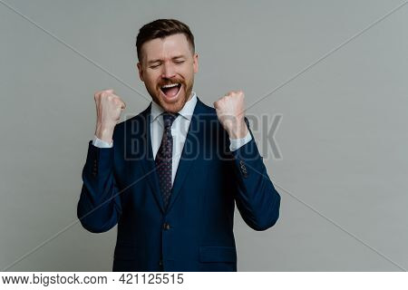 Business Success And Achievement. Excited Happy Businessman In Formal Wear Suit Celebrating Success