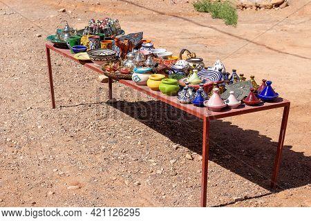 Selling Colorful Ceramic Souvenirs To Tourists Near Ancient Ait Benhaddou Kasbah Near Ouarzazate Cit