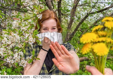 Season Allergy To Flowering Plants Pollen. Young Woman With Paper Handkerchief Covering Her Nose In