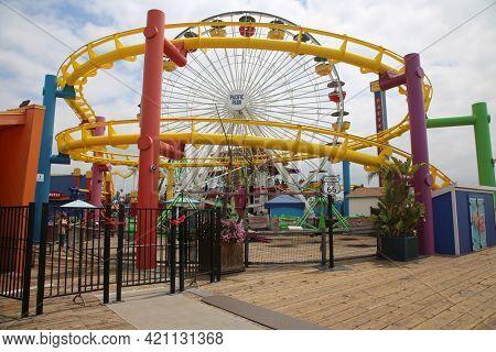 May 14, 2021 Santa Monica California, USA: Carnival Rides on the Santa Monica Pier. People enjoy fun rides on the end of the Santa Monica Pier in California. Editorial Use.