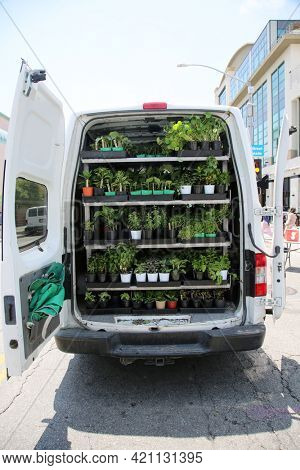 May 14, 2021 Santa Monica California, USA: Van filled with potted plants for sale at a farmers market. Editorial use only.