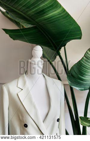 White blazer on a pinnable mannequin