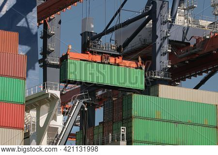 Cargo containers loaded on a huge ship in an intermodal freight terminal
