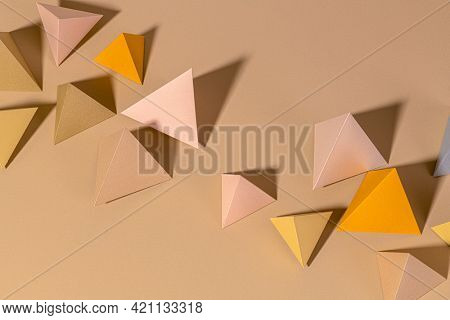 3D pyramid papercraft on a beige background