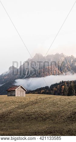 Wooden cabin in the hills near the Dolomites, Italy