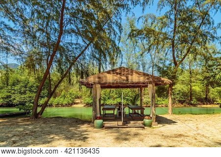 Asian-style wooden arbor near the small river. Chang island, Thailand
