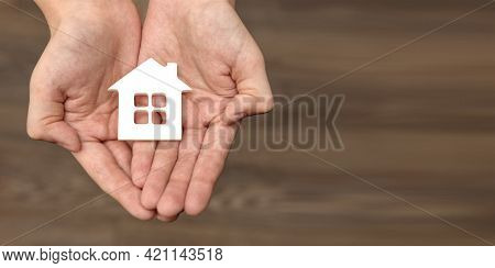 Hands Are Holding A Toy House. Real Estate Purchase, Homeless Housing And Real Estate, Family Home I