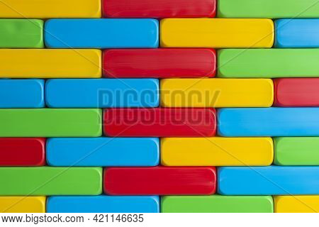 Kids Playing Large Blocks For Education. Brick Wall Made Of Huge Lightweight Plastic Building Blocks