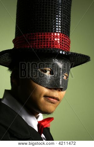 Asian Man In Mask And Top Hat