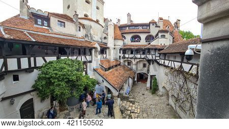 Bran, Romania - May 16, 2021: Tourists Visit The Bran Castle, Known Also As Dracula's Castle In Tran