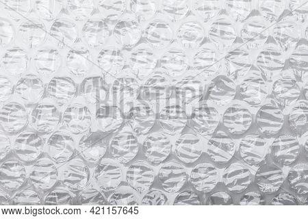 Bubble wrap pliable transparent plastic air cushion material on white background