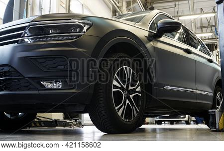 Moscow Russia-may 20 2021: Luxury Black Suv Car In A Car Service Station. In The Background, The Int