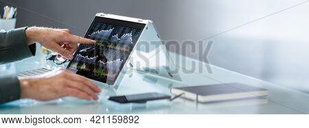 Stock Exchange Exchange Software On Laptop, Man Looking At Graph