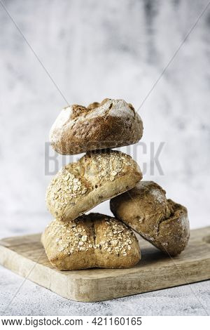 Various Buns Made From Whole Grain Or Plain Flour On A Wooden Board. Traditional Bakery Products. Ba