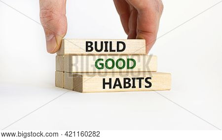 Build Good Habits Symbol. Wooden Blocks With Words 'build Good Habits'. Businessman Hand. Beautiful