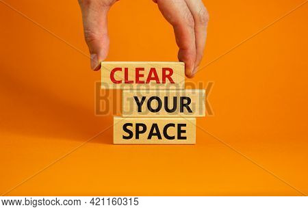 Clear Your Space Symbol. Wooden Blocks With Words 'clear Your Space'. Beautiful Orange Background, B