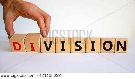 Division Or Vision Symbol. Businessman Turns Wooden Cubes And Changes The Word 'division' To 'vision