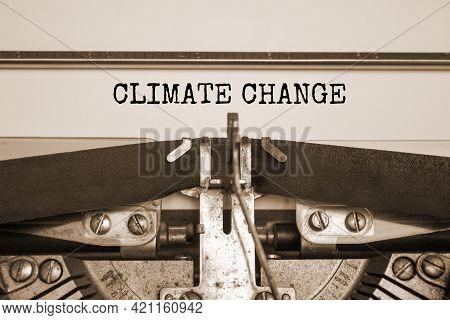 Climate Change Symbol. Words 'climate Change' Typed On Retro Typewriter. Beautiful White Background,