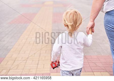 Mother Hold Sun Hand. Outdoor Family Lifestyle. Mentor Concept. Trust Assistance. Parent Help. Littl