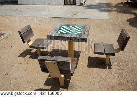 May 14, 2021 Santa Monica California, USA: Chess and Checkers Tables outdoors. Outdoor Chess and Checkers Club with tables for people to enjoy the game. Editorial Use.