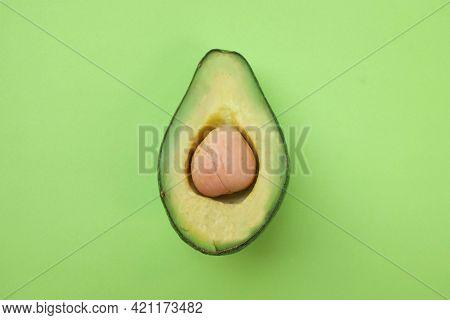 Fresh Green Avocado Fruit Halves Isolated On Green Pastel Background. Green Avocadoes, Minimal Flat