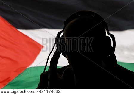 Silhouette Of A Man In Headphones, Eavesdropping On A Secret Agent, Spy And Scout, Palestine Flag, B