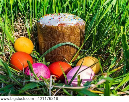 Colored Chicken Easter Eggs In Green Grass. Easter Holiday. Bread. Egg. Green Grass. Christian Relig