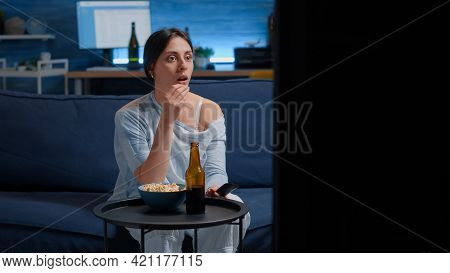 Emotional Young Woman Eating Popcorn While Watching Disgusting Tv Program Movie Alone In Living Room