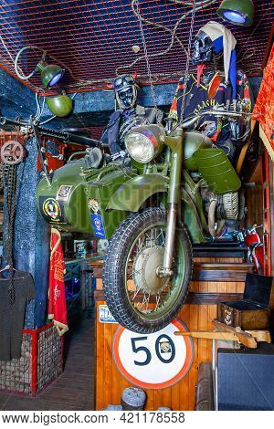 Uzhhorod, Ukraine - Nov 22, 2008: Interior Of Bikers Bar. Motorbike With Skeleton Riders On The Wall