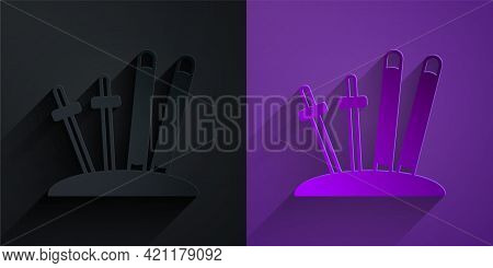 Paper Cut Ski And Sticks Icon Isolated On Black On Purple Background. Extreme Sport. Skiing Equipmen