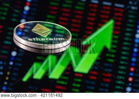 Ethereum Coin On The Background Of A Large Green Arrow Pointing Up. The Concept Of Ethereum Exchange