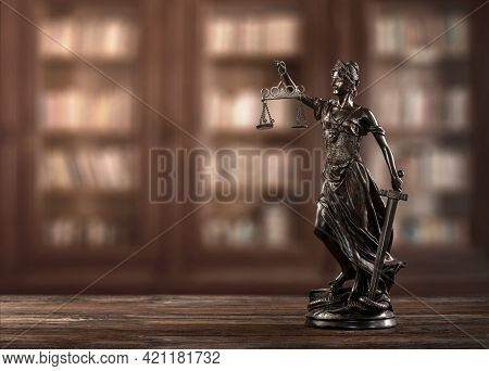 Close Up Of Themis, Justice Woman Figure On A Desk With Copy Spcae