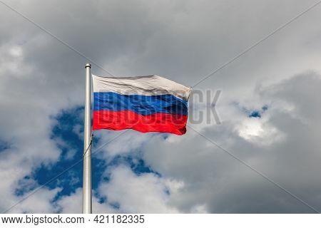Flag Of The Russian Federation On The Background Of A Cloudy Sky