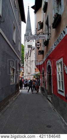 Hallstatt, Austria - May 18, 2019: This Is One Of The Narrow Streets Of The Medieval Austrian Town O