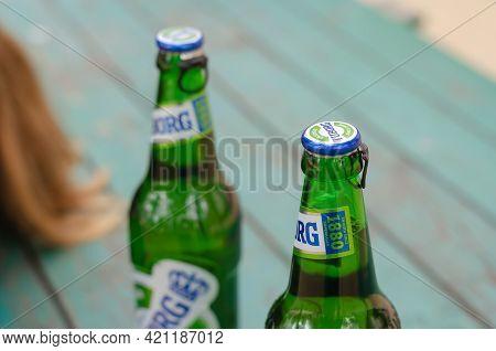 Two Beers Tuborg Green Close-up. Full Beer Bottles Of The Famous Lager Beer. Nikolaev, Ukraine - Apr