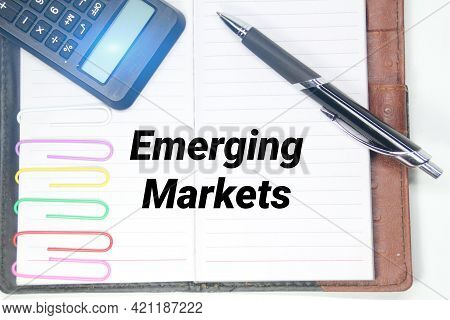 Emerging Market Writing Concepts With Pens, Books And Calculators