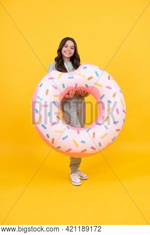 Cheerful Beach Child In Tracksuits With Rubber Ring On Summer Vacation On Yellow Background, Summer.