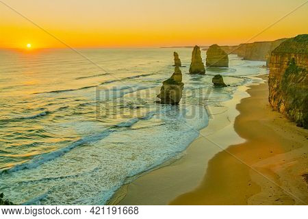 Sunset View Of The Twelve Apostles Limestone Stacks, By The Great Ocean Road In Victoria, Australia