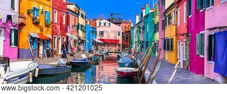 Burano is a picturesque island near Venice in Venetian Lagoon famous with canals and coorful houses. Italy, Veneto,  november 2020