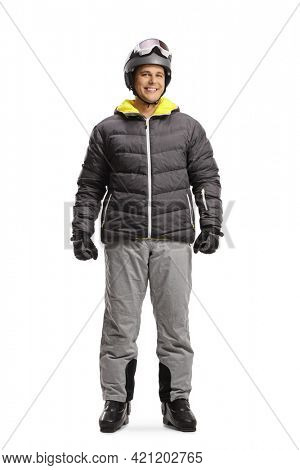 Full length portrait of a young man wearing a ski helmet and boots isolated on white background