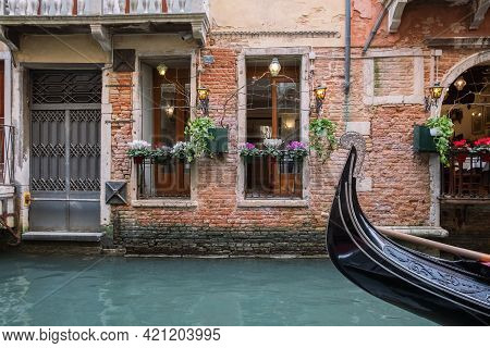Canal In Venice, Wall Of An Old House Close-up. Beautiful Windows And A Fragment Of A Gondola.