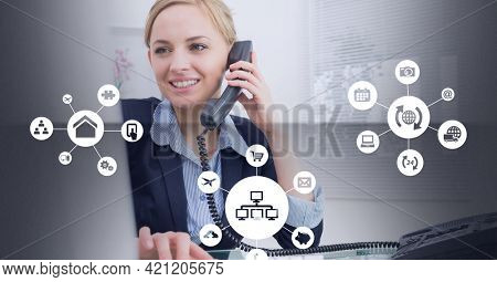 Composition of networks of digital icons over businesswoman talking on phone. global online business, networking and digital interface concept digitally generated image.